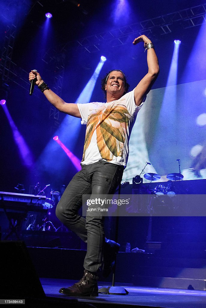 <a gi-track='captionPersonalityLinkClicked' href=/galleries/search?phrase=Carlos+Vives&family=editorial&specificpeople=235771 ng-click='$event.stopPropagation()'>Carlos Vives</a> performs at American Airlines Arena on July 13, 2013 in Miami, Florida.
