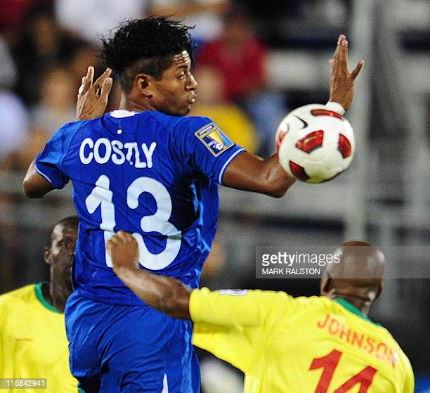 Carlos Yaír Costly of Honduras heads the ball above Leon Johnson of Grenada during their CONCACAF Gold Cup match at the FIU Stadium in Miami Florida...