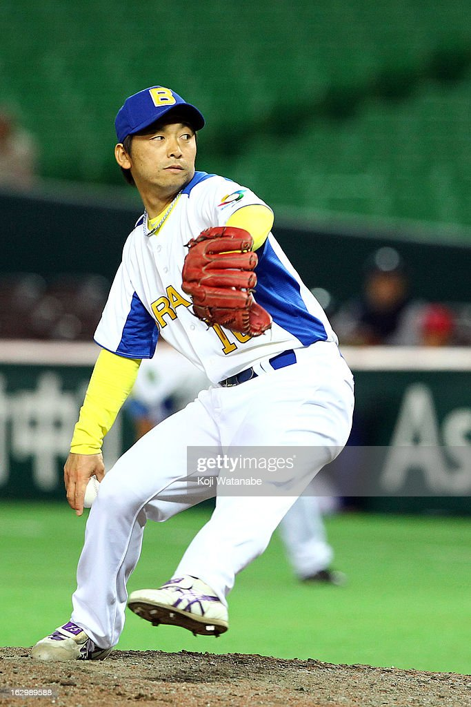 Carlos Yoshimura #18 of Brazil pitcher against Cuba during the World Baseball Classic First Round Group A game between Brazil and Cuba at Fukuoka Yahoo! Japan Dome on March 3, 2013 in Fukuoka, Japan.