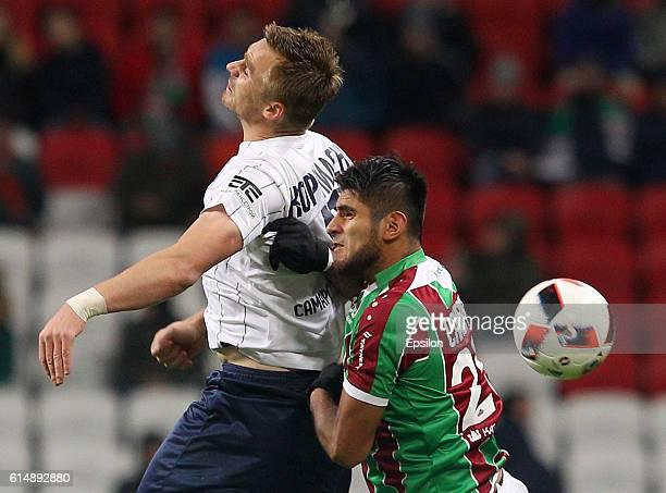 Carlos Zambrano of FC Rubin Kazan vies for the ball with Sergei Kornilenko of PFC Krylia Sovetov Samara during the Russian Premier League match...