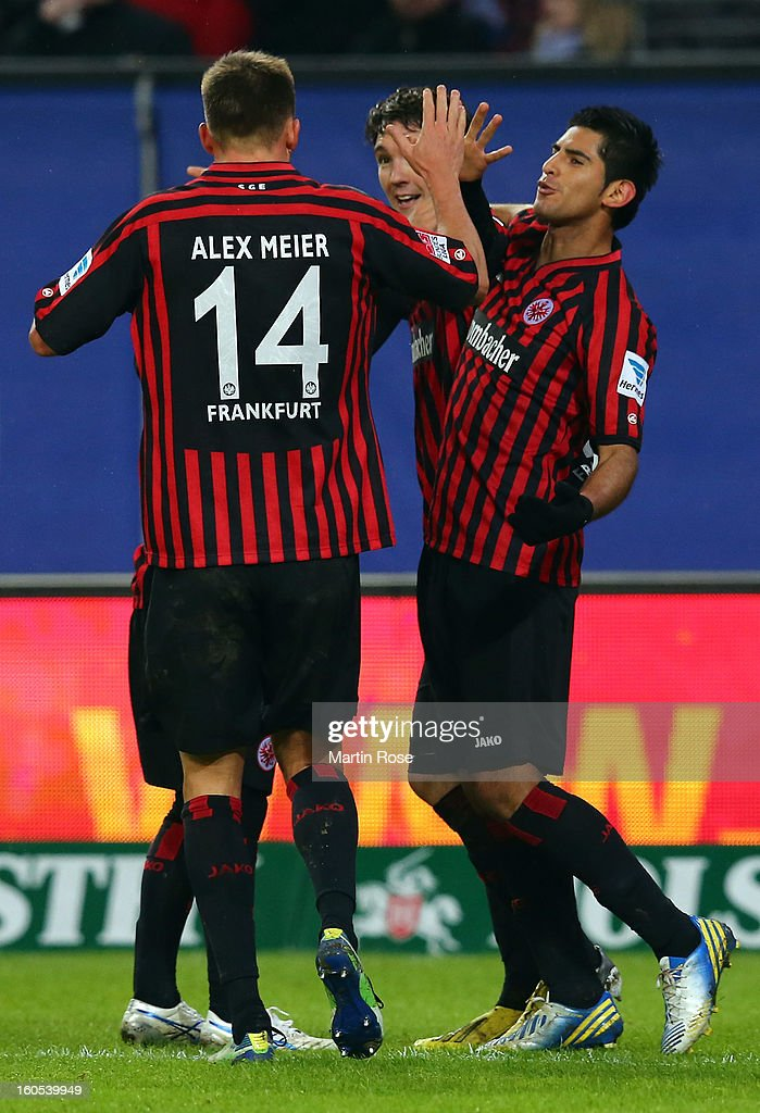 Carlos Zambrano (R) of Frankfurt celebrate with his team mates his team's 2nd goal during the Bundesliga match between Hamburger SV and Eintracht Frankfurt at Imtech Arena on February 2, 2013 in Hamburg, Germany.