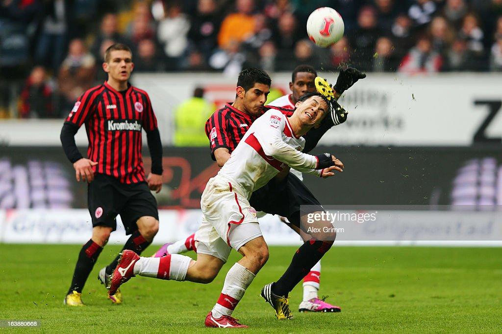 Carlos Zambrano (back) of Frankfurt clears the ball ahead of Shinji Okazaki of Stuttgart during the Bundesliga match between Eintracht Frankfurt and VfB Stuttgart at Commerzbank-Arena on March 17, 2013 in Frankfurt am Main, Germany.