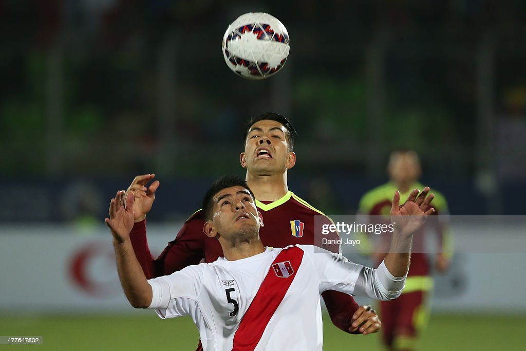 <a gi-track='captionPersonalityLinkClicked' href=/galleries/search?phrase=Carlos+Zambrano&family=editorial&specificpeople=203225 ng-click='$event.stopPropagation()'>Carlos Zambrano</a> of Peru goes for a header with <a gi-track='captionPersonalityLinkClicked' href=/galleries/search?phrase=Nicolas+Fedor&family=editorial&specificpeople=880188 ng-click='$event.stopPropagation()'>Nicolas Fedor</a> of Venezuela during the 2015 Copa America Chile Group C match between Peru and Venezuela at Elías Figueroa Brander Stadium on June 18, 2015 in Valparaiso, Chile.