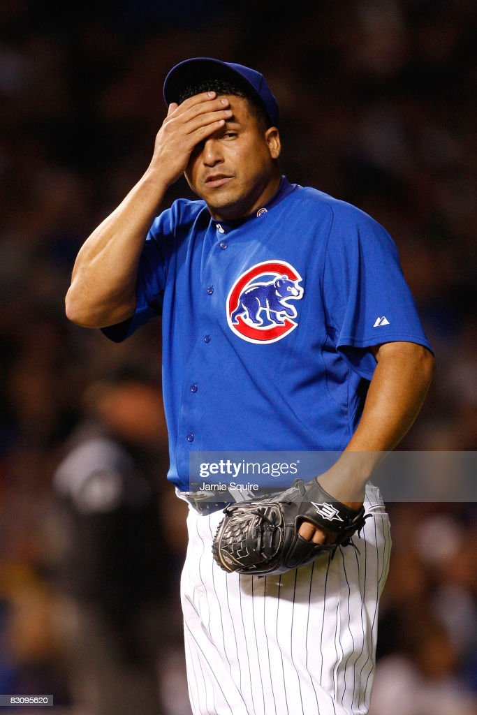 Carlos Zambrano #38 of the Chicago Cubs wipes his forehead in the top of the second inning against the Los Angeles Dodgers in Game Two of the NLDS during the 2008 MLB Playoffs at Wrigley Field on October 2, 2008 in Chicago, Illinois.