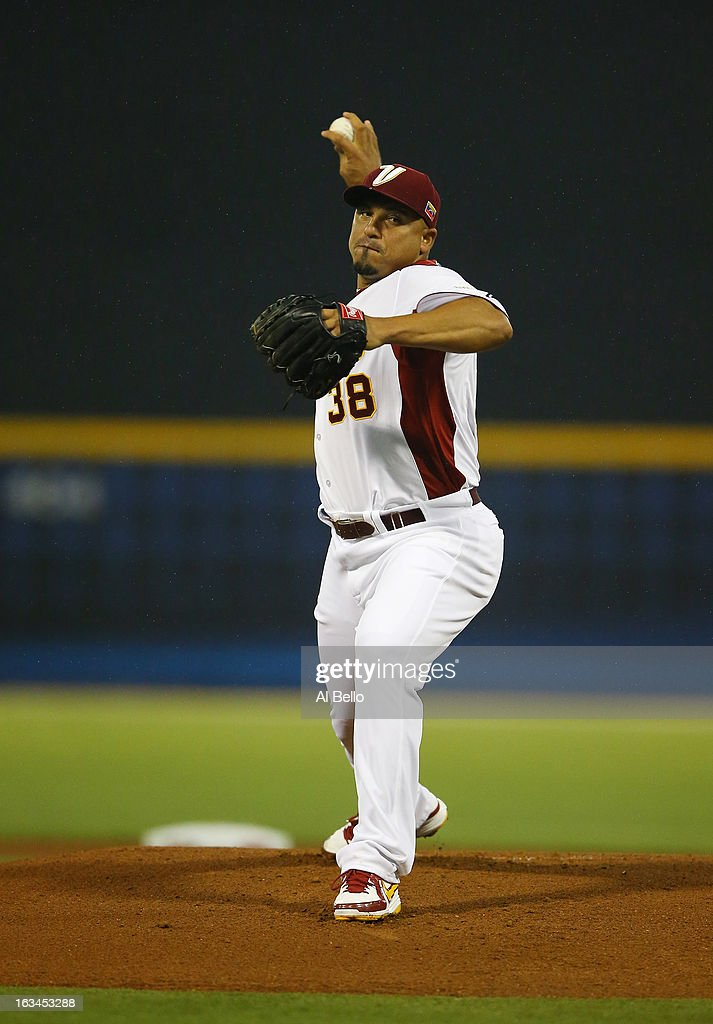 <a gi-track='captionPersonalityLinkClicked' href=/galleries/search?phrase=Carlos+Zambrano&family=editorial&specificpeople=203225 ng-click='$event.stopPropagation()'>Carlos Zambrano</a> #38 of Venezuela pitches against Puerto Rico during the first round of the World Baseball Classic at Hiram Bithorn Stadium on March 9, 2013 in San Juan, Puerto Rico.