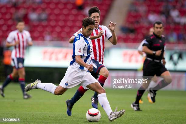 Carlos Zamora of Chivas fights for the ball with Otavio Monteiro of Porto during the friendly match between Chivas and Porto at Chivas Stadium on...