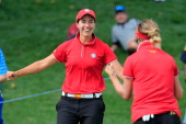 Carlota Ciganda and Belen Mozo of Spain celebrate on the 16th green after Spain won the International Crown at Cave Valley Golf Club on July 27 2014...
