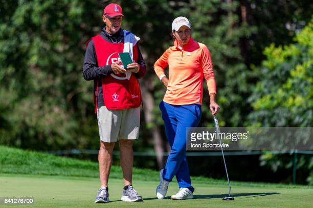 Carlota Ciganda discusses strategy with her caddie as others putt on the 12th hole during the first round of the Canadian Pacific Women's Open on...