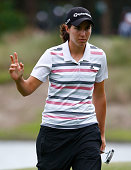 Carlota Ciganda of Spain acknowledges the crowd on the 16th hole during the second round of the CME Group Tour Championship at Tiburon Golf Club on...