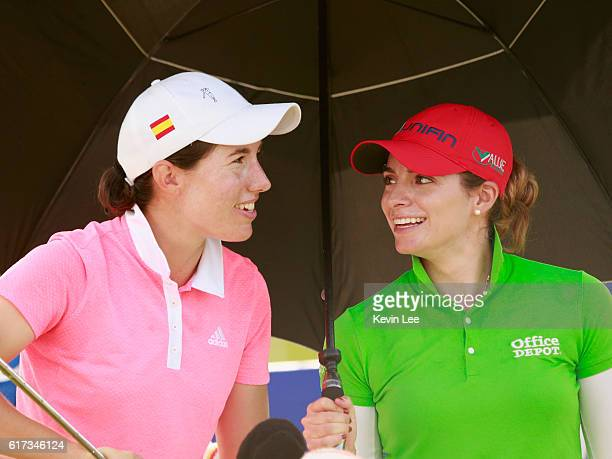 Carlota Ciganda of Spain and Gaby Lopez of Mexico chats before their tee off at 1st green during the final round of Blue Bay LPGA on Day 4 on October...