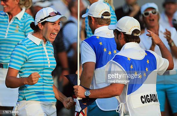 Carlota Ciganda of Spain and the European Team celebrates with her caddie Javier Urquizu after Ciganda made a birdie putt on the 18th hole to win the...