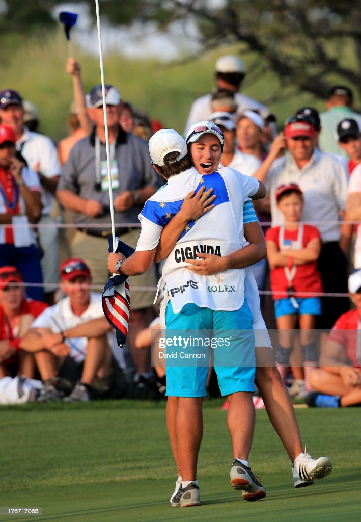Carlota Ciganda of Spain (L) and the European Team celebrates with her caddie Javier Urquizu on the 18th green after she had holed a match winning birdie putt against Gerina Piller and Angela Stanford during the afternoon fourball matches for the 2013 Solheim Cup at The Colorado Golf Club on August 17, 2013 in Parker, Colorado.