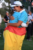 Carlota Ciganda of Spain and the European Team embraces her teammate Azahara Munoz of Spain after Ciganda made a birdie putt on the 18th hole to win...