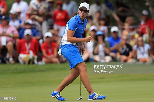 Carlota Ciganda of Spain and the European Team reacts after sinking a birdie putt to win the 15th hole against Morgan Pressel of the United States...