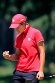 Carlota Ciganda of Spain celebrates on the 4th green after putting out during the International Crown at Cave Valley Golf Club on July 27 2014 in...