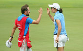 Carlota Ciganda of Spain celebrates with her caddie after her birdie on the 18th hole during the second round of the HSBC Women's Champions at...