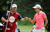 Carlota Ciganda of Spain celebrates with her caddie Mark Wallington after an eagle putt on the second hole during the final round of the Lorena Ochoa...