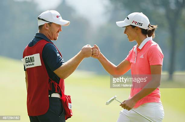 Carlota Ciganda of Spain celebrates with her caddie Mark Wallington after an birdie putt on the 11th hole during the final round of the Lorena Ochoa...