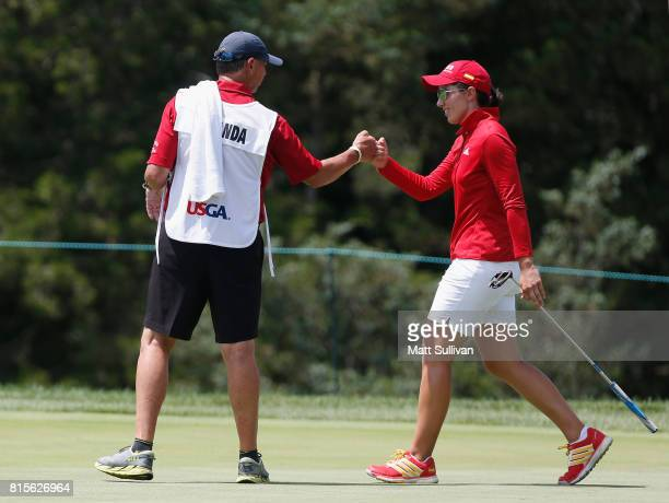 Carlota Ciganda of Spain celebrates with her caddie Terry Mcnamara after making a birdie on the first hole during the final round of the US Women's...