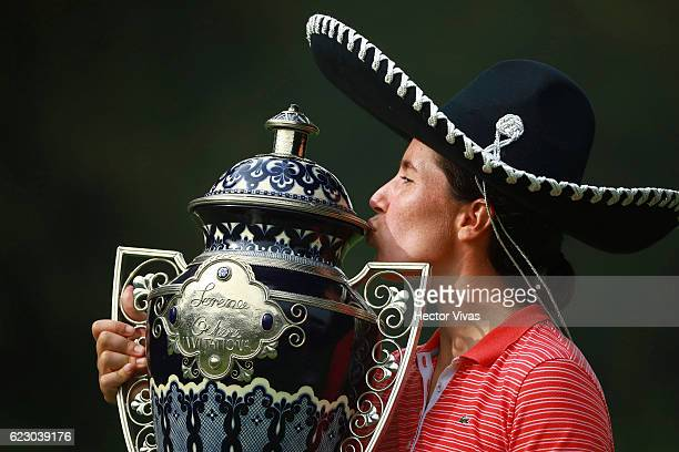 Carlota Ciganda of Spain celebrates with the trophy after winning the Lorena Ochoa Invitational 2016 at Club de Golf on November 13 2016 in Mexico...