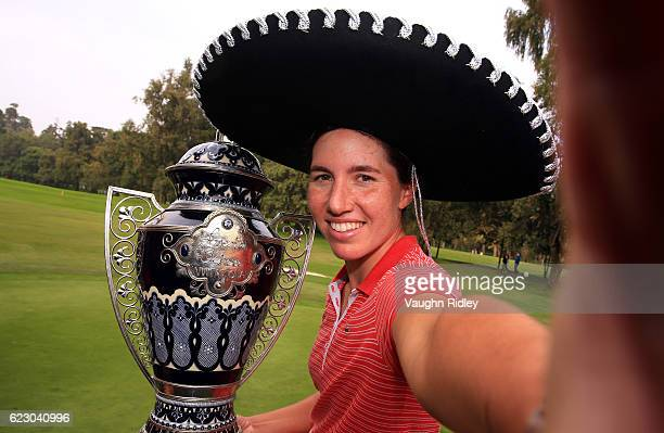 Carlota Ciganda of Spain imitates a âselfie❠as she poses with the winners trophy following the final round of the Citibanamex Lorena Ochoa...