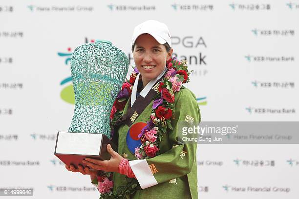 Carlota Ciganda of Spain lifts the winners trophy during a ceremony following the LPGA KEBHana Bank Championship at the Sky 72 Golf Club Ocean Course...