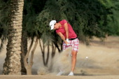 Carlota Ciganda of Spain plays her second shot at the par 4 14th hole during the third round of the 2013 Omega Dubai Ladies Masters on the Majilis...