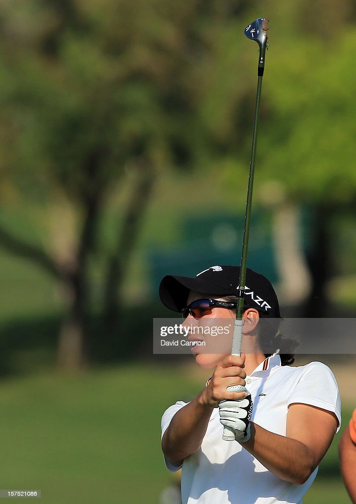 Carlota Ciganda of Spain plays her second shot at the par 4, 17th hole during the pro-am as a preview for the 2012 Omega Dubai Ladies Masters on the Majilis Course at the Emirates Golf Club on December 4, 2012 in Dubai, United Arab Emirates.