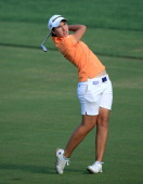 Carlota Ciganda of Spain plays her second shot at the par 5 10th hole during the second round of the 2013 Omega Dubai Ladies Masters on the Majilis...