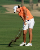 Carlota Ciganda of Spain plays her third shot at the par 5 10th hole during the second round of the 2013 Omega Dubai Ladies Masters on the Majilis...