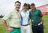 Carlota Ciganda of Spain poses with her uncle José Ángel Ziganda and father behind the ninth green during the second round of the HSBC Women's...