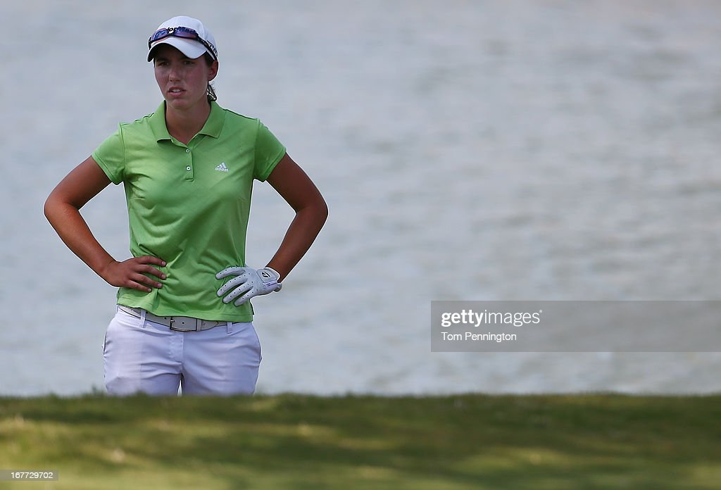 Carlota Ciganda of Spain reacts after hitting into the water on the 15th hole during the final round of the 2013 North Texas LPGA Shootout at the Las Colinas Counrty Club on April 28, 2013 in Irving, Texas.