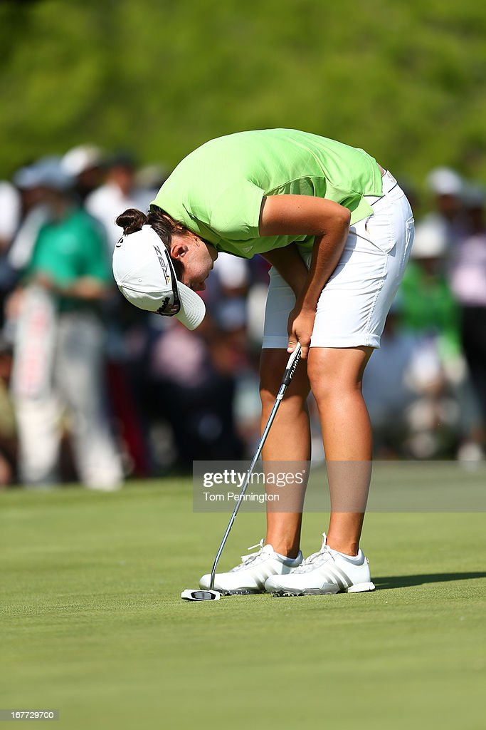 Carlota Ciganda of Spain reacts after missing a putt on the 16th hole during the final round of the 2013 North Texas LPGA Shootout at the Las Colinas Counrty Club on April 28, 2013 in Irving, Texas.
