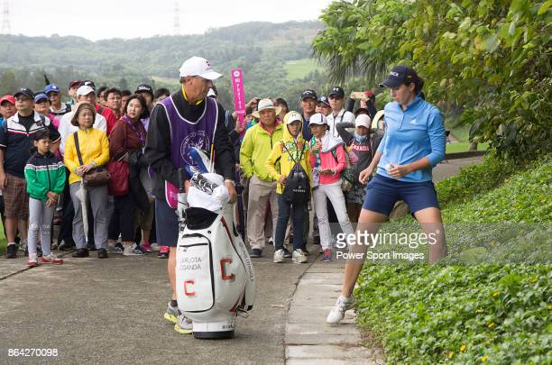 Carlota Ciganda of Spain retrieves the ball from bushes next to a cart path on the 4th hole during day three of the Swinging Skirts LPGA Taiwan...