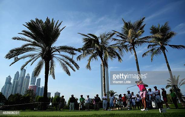 Carlota Ciganda of Spain tees off on the ninth hole during the third round of the 2013 Omega Dubai Ladies Masters on the Majilis Course at the...