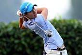 Carlota Ciganda of Spain watches her tee shot on the 10th hole during the Sime Darby LPGA at Kuala Lumpur Golf Country Club on October 9 2014 in...