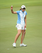 Carlota Ciganda of Spain waves to the crowd after her birdie on the 18th hole during the second round of the HSBC Women's Champions at Sentosa Golf...