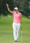 Carlota Ciganda of Spain waves to the galery on the 18th green after a nineunder par 63 during the final round of the Lorena Ochoa Invitational...
