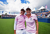 Carlota Ciganda of team Europe celebrates with playing partner Melissa Reid during the morning foursomes matches at The Solheim Cup at St LeonRot...