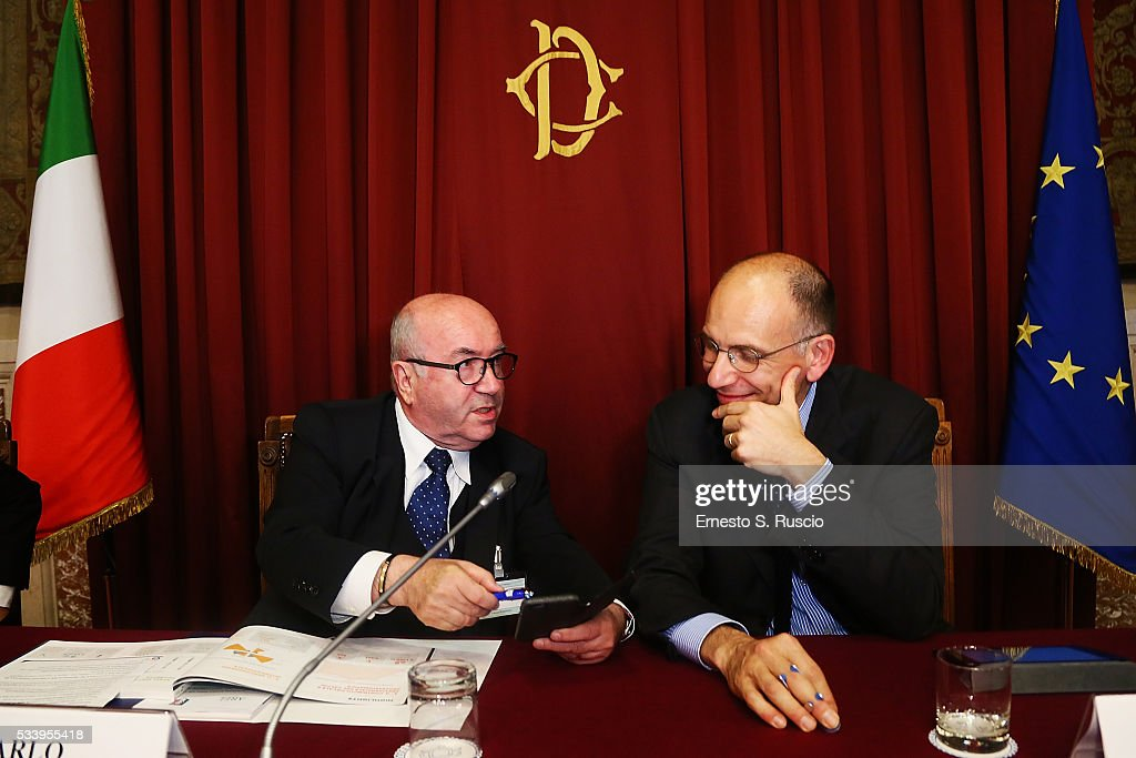 CarloTavecchio and <a gi-track='captionPersonalityLinkClicked' href=/galleries/search?phrase=Enrico+Letta&family=editorial&specificpeople=2915592 ng-click='$event.stopPropagation()'>Enrico Letta</a> attend the Italian Football Federation Unveils Annual Report at Palazzo Montecitorio on May 24, 2016 in Rome, Italy.