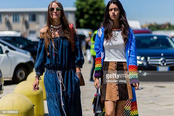 Carlotta Oddi wearing a off shoulder Chloe denim dress and Chiara Totire outside Gucci during the Milan Men's Fashion Week Spring/Summer 2017 on June...