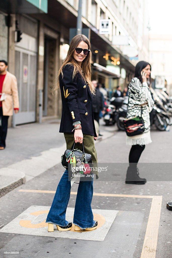 Carlotta Oddi wears a Palm Angels jacket Isabel Marant tshirt and skirt Hudson jeans Prada shoes and Saint Laurent bag and Spektre sunglasses on...
