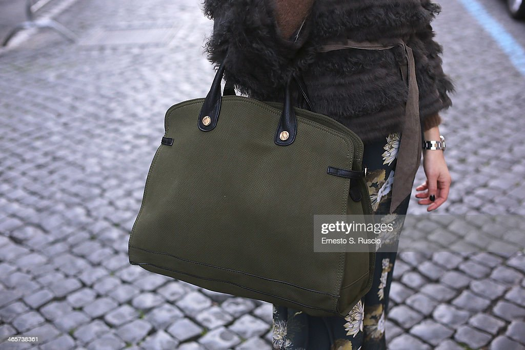 Carlotta Valentini wears Cassiopea bag, Top Shop jumpsuit and P.A.R.O.S.H fur on day 3 Rome Fashion Week Spring/Summer 2014, on January 26, 2014 in Paris,in Rome, Italy.