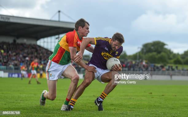 Carlow Ireland 21 May 2017 Brian Malone of Wexford in action against Sean Gannon of Carlow during the Leinster GAA Football Senior Championship Round...
