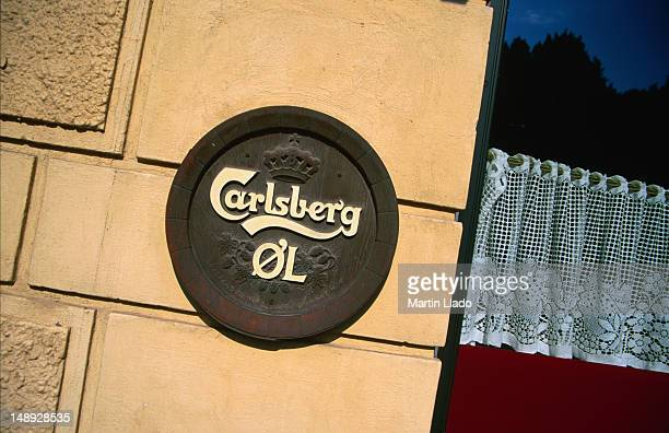 Carlsberg lager sign decorating the outside wall of a bar in Bentzonsvej, Copenhagen.