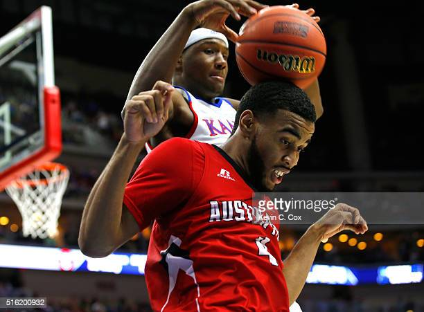 Carlton Bragg Jr #15 of the Kansas Jayhawks and Josh Robinson of the Austin Peay Governors compete for a loose ball in the second half during the...