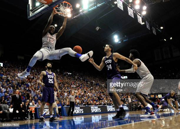 Carlton Bragg Jr #15 of the Kansas Jayhawks dunks against Alex Robinson and Kenrich Williams of the TCU Horned Frogs in the first half at Allen...