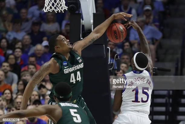 Carlton Bragg Jr #15 of the Kansas Jayhawks is defended by Nick Ward of the Michigan State Spartans during the second round of the 2017 NCAA Men's...