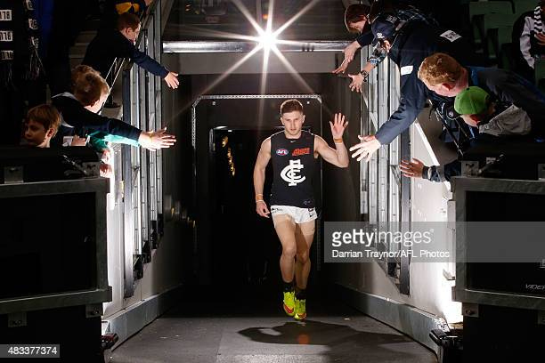 Carlton captain Marc Murphy walks up the race after the half time break during the round 19 AFL match between the Collingwood Magpies and Carlton...