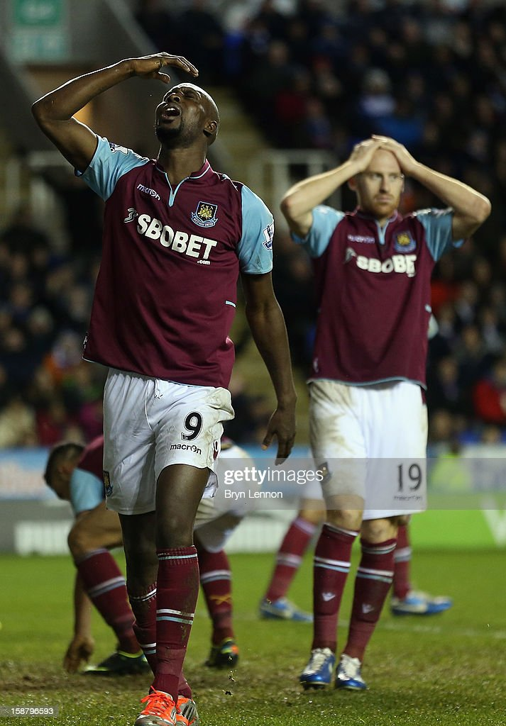 Carlton Cole (l) and James Collins react to a missed goal opportunity during the Barclays Premier League match between Reading and West Ham United at the Madejski Stadium on December 29, 2012 in Reading, England.